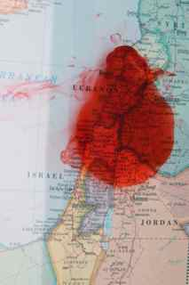 Map of Israel with blood on it