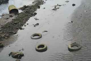 Contaminated River with Tires
